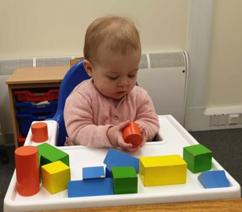 Elevated likelihood of autism and ADHD influences infants' motor development